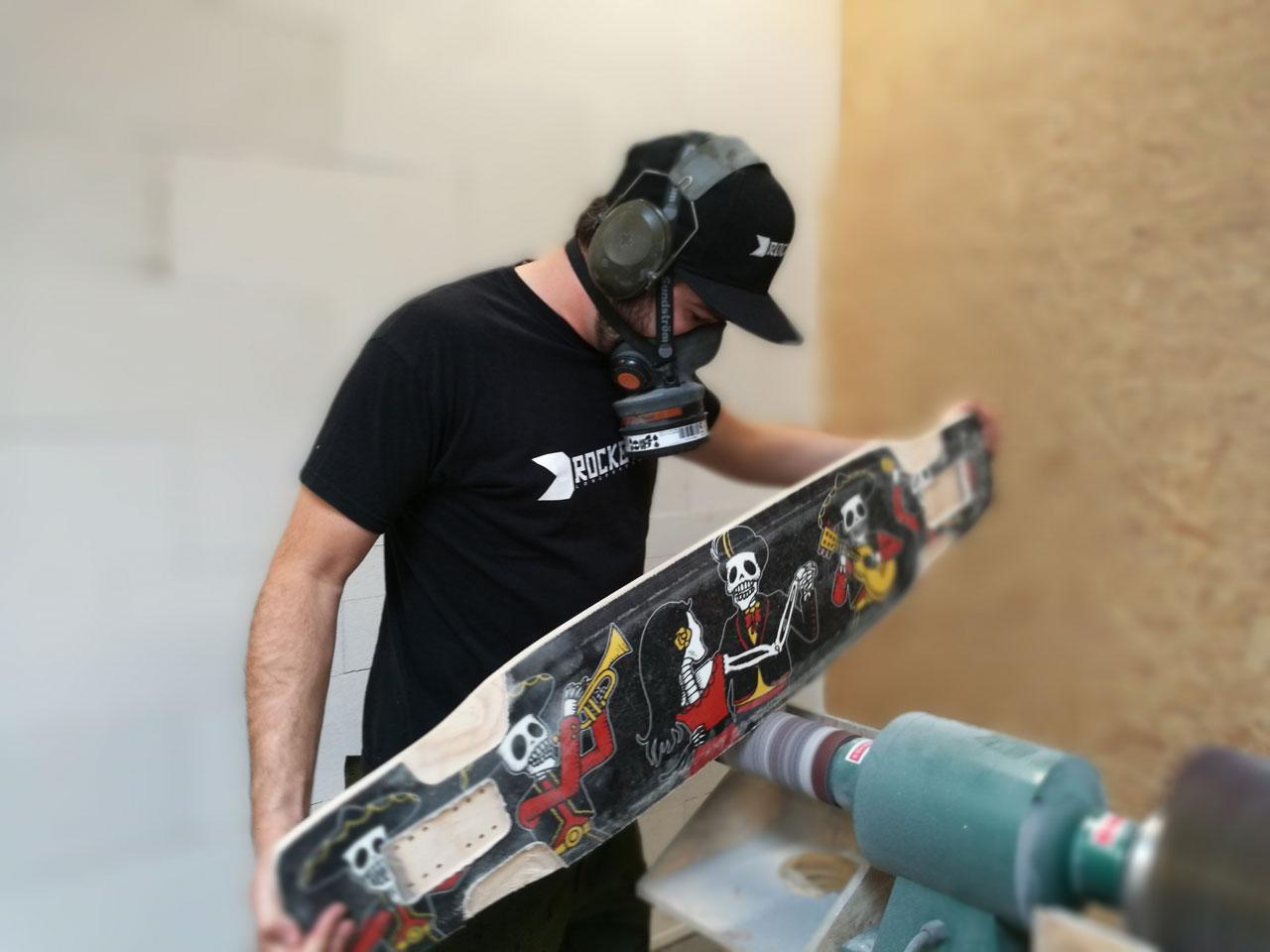 Daniel Iseli sanding a board. Photo ROCKET Longboards
