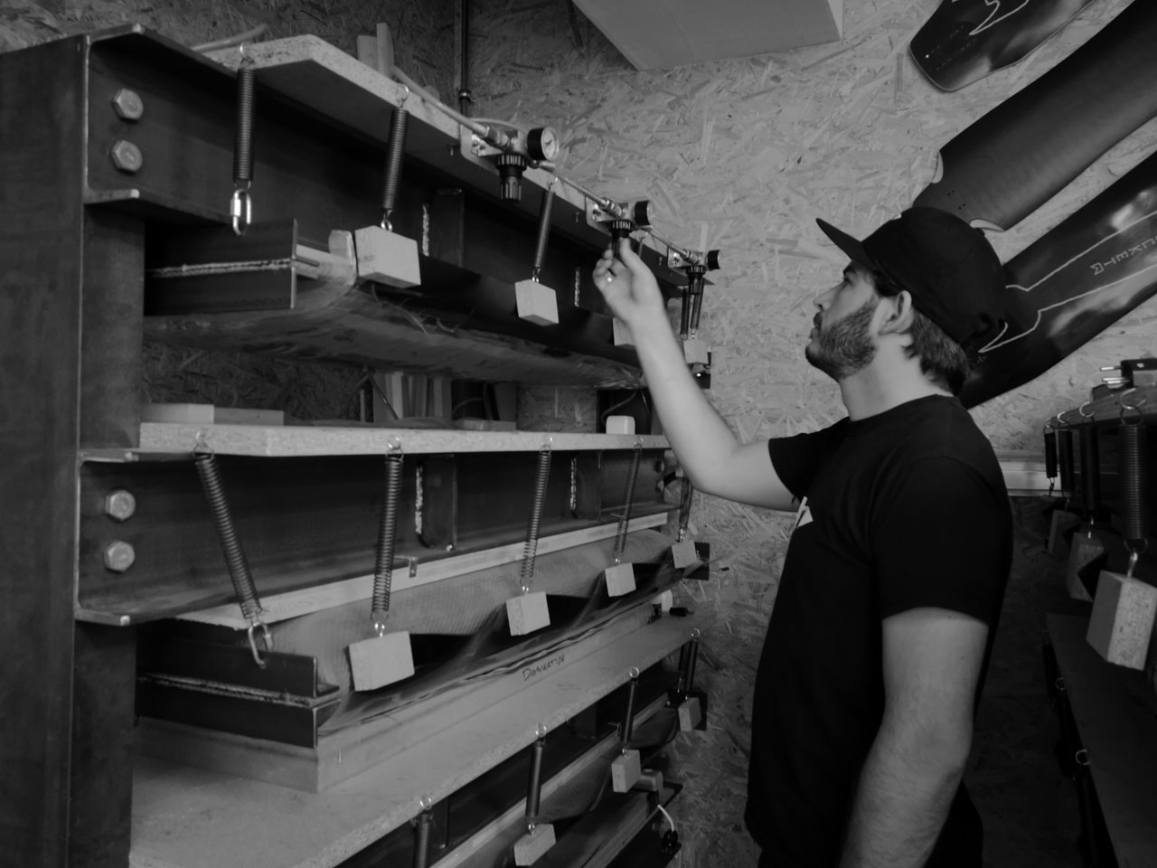 Daniel Iseli handling the presses. Photo ROCKET Longboards